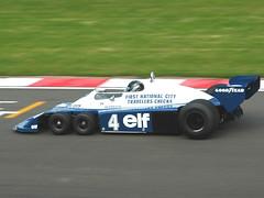 stock car racing(0.0), performance car(0.0), dirt track racing(0.0), indycar series(0.0), formula one(0.0), porsche 962(0.0), race car(1.0), auto racing(1.0), automobile(1.0), racing(1.0), vehicle(1.0), race(1.0), open-wheel car(1.0), formula racing(1.0), motorsport(1.0), sports prototype(1.0), formula one car(1.0), race track(1.0), land vehicle(1.0), sports car(1.0),