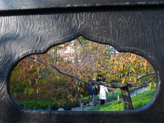 Visitors take a fall foliage filled stroll through the Japanese Hill-and-Pond Garden. Photo by Rebecca Bullene.