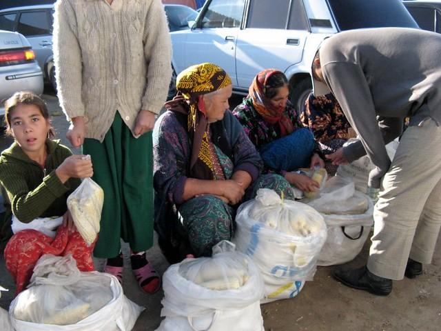 women selling corn