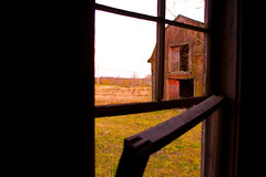Abandoned farm, outbuilding window, looking out