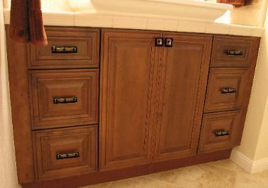Knobs and pulls on bathroom vanity with uneek glass fusion - Bathroom vanity knobs and handles ...
