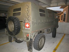 armored car(1.0), automobile(1.0), automotive exterior(1.0), military vehicle(1.0), commercial vehicle(1.0), sport utility vehicle(1.0), vehicle(1.0), armored car(1.0), bumper(1.0),