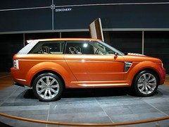 range rover evoque(0.0), automobile(1.0), automotive exterior(1.0), range rover(1.0), sport utility vehicle(1.0), wheel(1.0), vehicle(1.0), automotive design(1.0), compact sport utility vehicle(1.0), rim(1.0), range stormer(1.0), land vehicle(1.0), luxury vehicle(1.0),