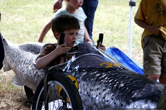nick at the wheel of a fishy adult soap box derby ca…