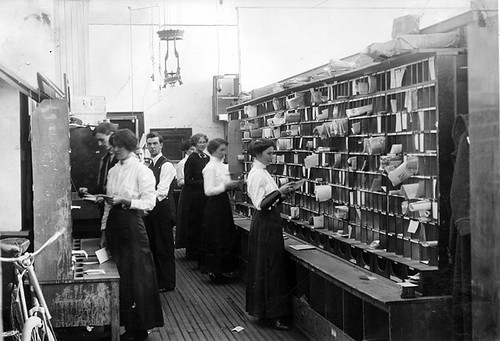Employees sort mail in the Lethbridge Post Office