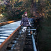 Panorama of Evelyn at the Vernonia Railroad Bridge - Brenizer Method by Mitchell Lea