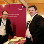 Fives Group delegates at exhibtion stand