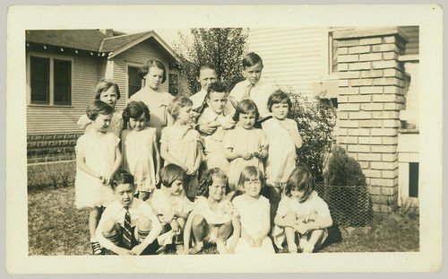 Group of children in a front yard