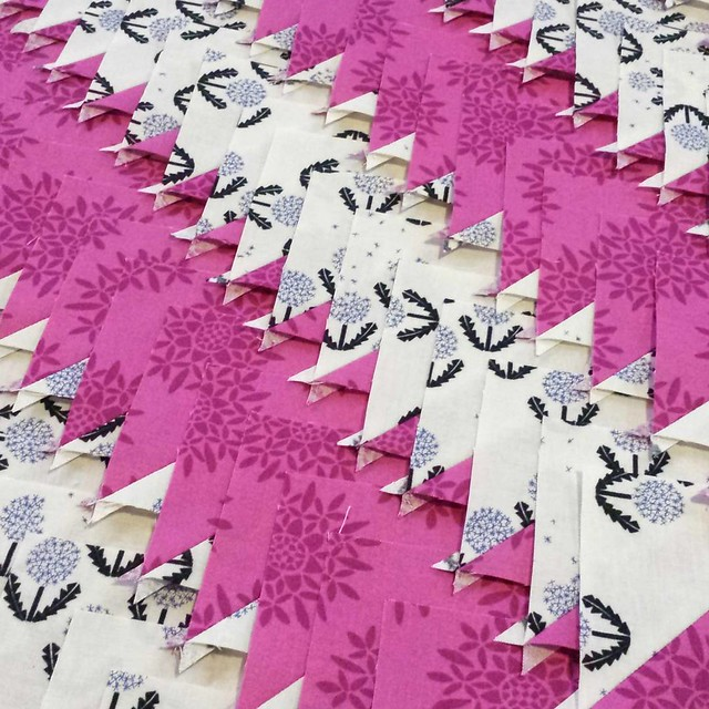 It's snowing here and I just finished pressing open 160 half square triangles.  I have another 160 waiting to be sewn on the sidelines. #birchenquilt #sewday