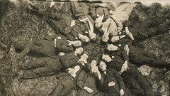 Group of young men lying in a circle