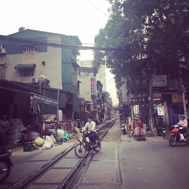 Casual rail lines running through the middle of street in Hanoi
