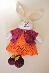Rabbit in stripey tights, orange lace dress and pink cardigan