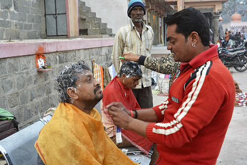 """""""The barbers will not be affected as much. There are 50 of us at Ramghat and the government has only asked us to remove the chairs, but we can perform our jobs without chairs also,"""" says Deepak Verma, a barber."""