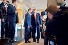 U.S. Secretary of State John Kerry speaks with Russian Foreign Minister Sergey Lavrov on February 11, 2016, before a bilateral meeting focused on Syria preceding the Munich Security Conference. [State Department Photo/ Public Domain]