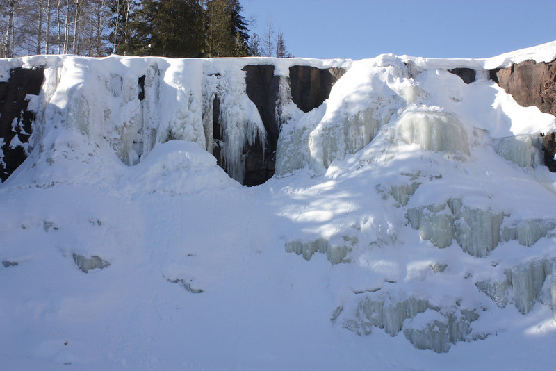 Looking up at the icy falls from immediately below, on the iced-over river