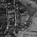 Aerial view of the village and castle in early 1942. © Cheshire Archaeology Service, Chester