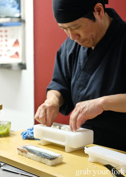 Chef Shinji Matsui making Kansai-style pressed sushi at Sashimi Shinsengumi, Crows Nest