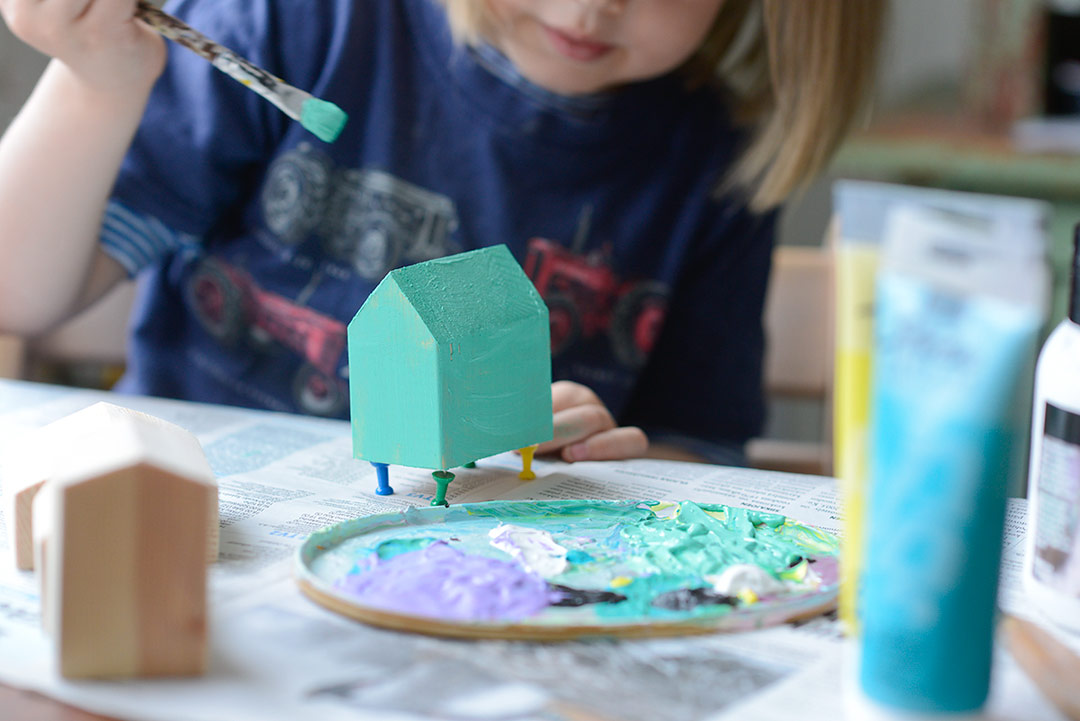 Painting a DIY toy wooden house