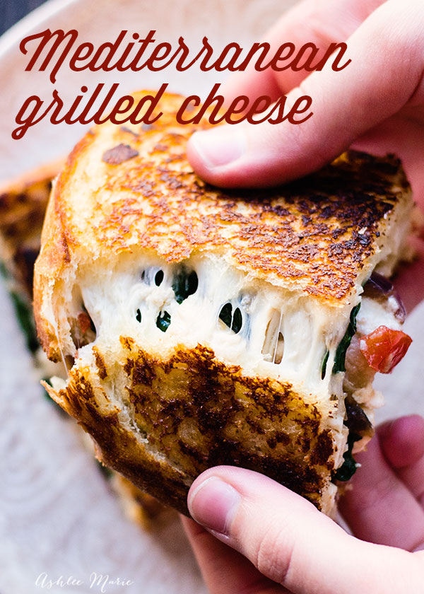 a fun twist on a classic grilled cheese, filled with spinach, onions, tomatoes, olives and more this Mediterranean sandwich is delicious