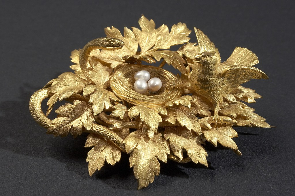 Brooch—gold with pearls, in the form of a bird's nest on a branch with rich foliage of lobed leaves.
