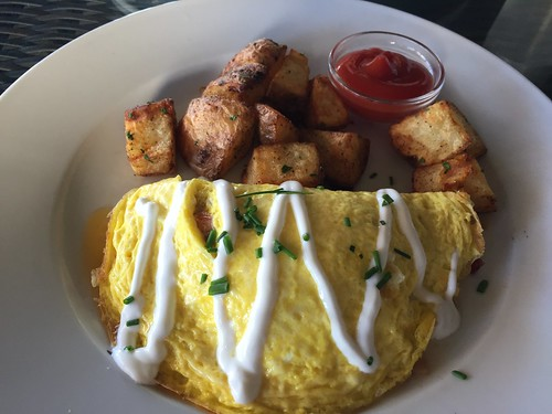 Applewood Smoked Bacon Omelet three eggs, bacon, mushrooms, tomato, tillamook cheddar, sour cream