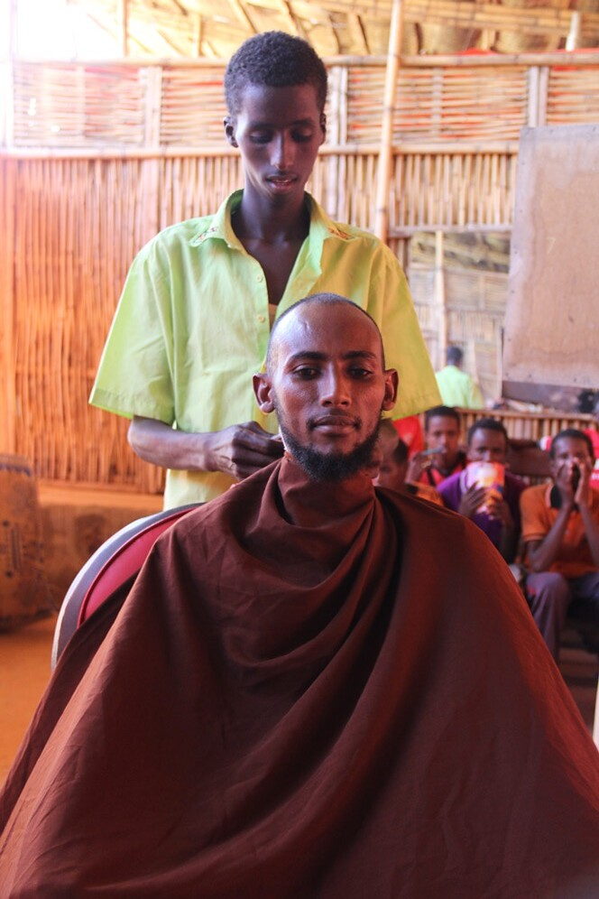 Somali refugees learn male barber skills as part of the JRS livelihoods project in Melkadida refugee camp (Angela Wells).