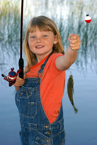 picture of little girl with fish