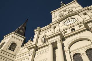 Image of Jackson Square. building tower clock architecture facade contrast landscape louisiana catholic cross cathedral spires neworleans sightseeing perspective sunny wideangle landmark historic clocktower spire southern frenchquarter jacksonsquare nola looming chartres romancatholic nawlins ruesainteanne ruesaintpierre ruedechartres metabones americanphotosafari
