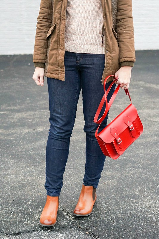 red hat + green winter coat + tan turtleneck sweater + red purse + jeans; Style On Target