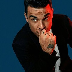 42 years, Robbie Williams http://offmag.blogspot.com.es/2016/02/robbie-williams.html  Williams' mother saw an advert for auditions to be in a new boy band which he applied for and, at age 16, was a member of Take That. After the incredible success of Take