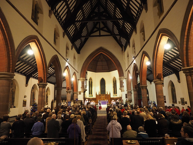 Photo of congregation at Carol Service looking to Chancel