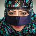 Iran, Hormozgan, Minab, a bandari woman wearing a traditional mask called the burqa at panjshambe bazar thursday market by Eric Lafforgue