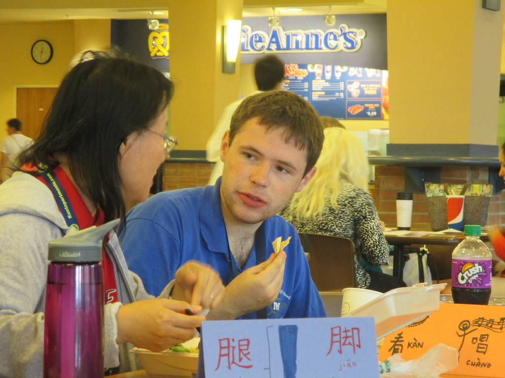 Chinese foreign language academy student at lunch in the Kent Student Center.