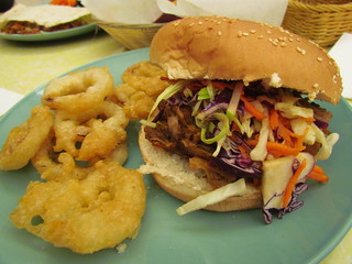 Long Arm of the Slaw Burger and Onion Rings at Two Bit Villains