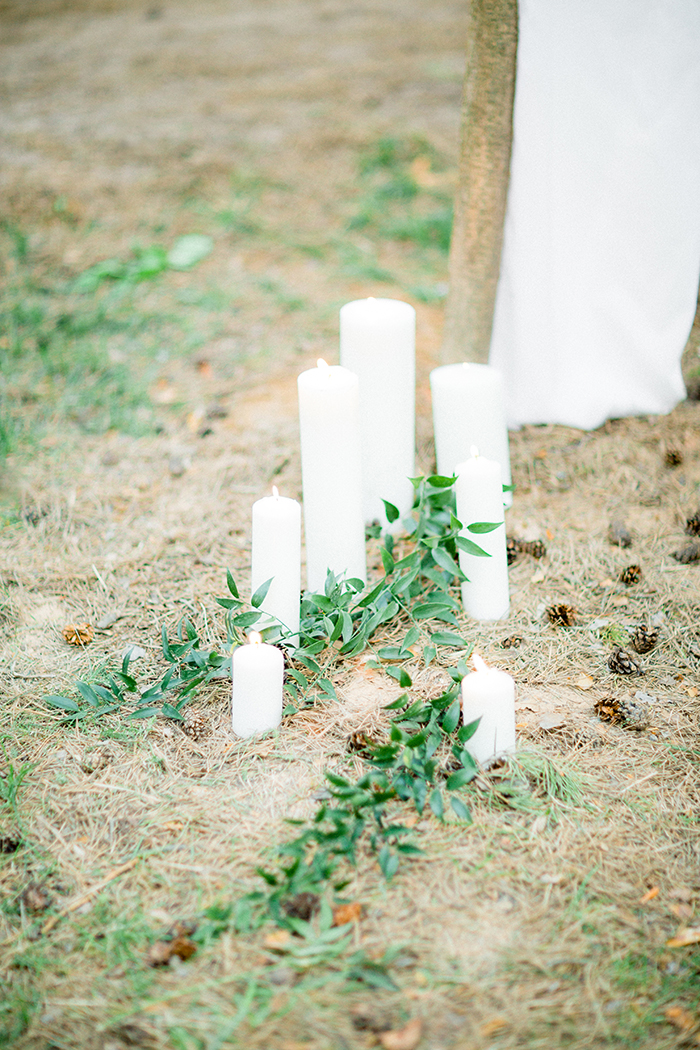 Candles and greenery decorated a Romantic Woodland Wedding Inspiration { Soft Peach Tones } | Photo by Igor Kovchegin Photography | Read more on Fab Mood - UK wedding blog