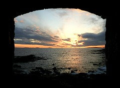 Sunset through a hole in a wall of a fortress #149