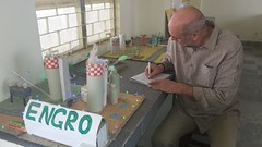 Mr. Carsten Mueller Signing the vistor's book along with comments during his visit to Sahara Welfare Society Daharki