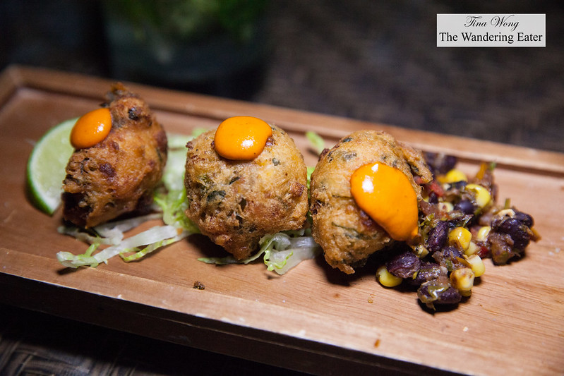 Smoked grouper fritters served with ackee and callaloo