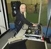 DJ Heather Van Vyper sets up beside the soccer pitch