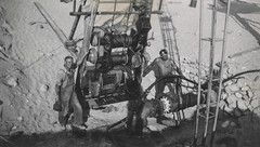 Men working with industrial equipment
