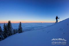 Die letzten Meter zum Gipfel, während die Sonne gerade aufgeht.
