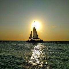 Eagle Beach Aruba.  Beautiful sunset as a sail ship crosses the sun. #sunset #sailship #catamaran #aruba #ariba #antilles #carribean #eaglebeacharuba #beach #sea #awesome_shots #greatpix