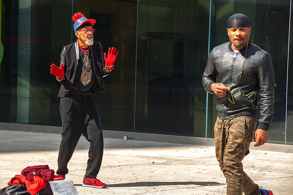 70-year-old man dancing for money--Center City