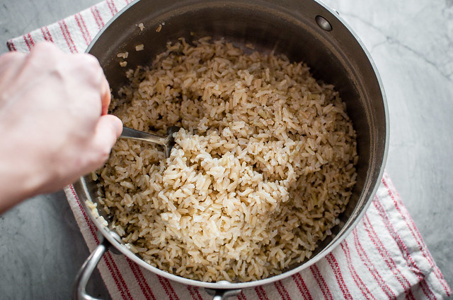 How to cook fluffy brown rice the easy way. Perfectly separated grains without any sticking, burning, or babysitting the pot and done in 30 minutes or less.