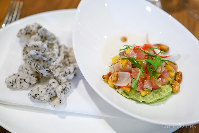 Hamachi Tarare with avocado, Thai chili, persimmon, puffed rice chip, cucumber and peanut