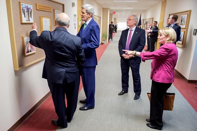 Secretary Kerry Looks at Display of Presidents and Saudi Kings at U.S. Embassy Riyadh