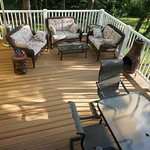 DuraLife Siesta decking in Golden Teak with White Railways railing