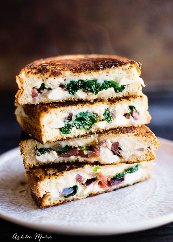 filed with three kinds of cheese, spinach, onions, tomatoes, olives and more this chicken Mediterranean grilled cheese is always a hit