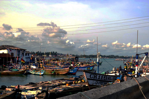 ocean africa sunset sea castle boats coast boat fishing colours afternoon painted flags ghana westafrica afrika westafrika afrique 2014 elmina centralregion غانا أفريقيا