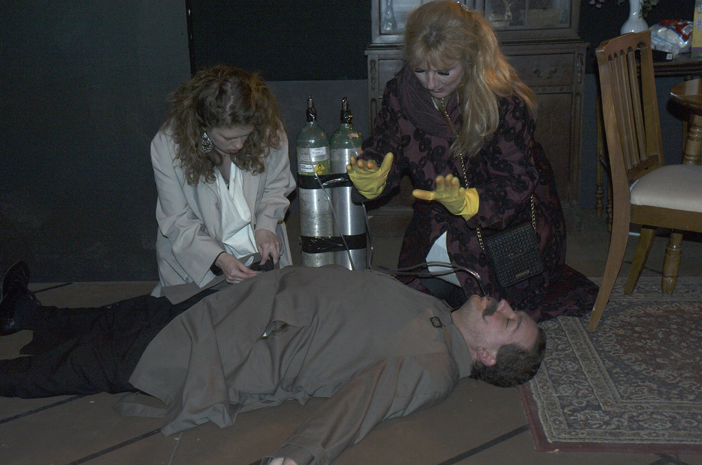 "<p>Moriah Whiteman as Margherita and Hanna Bondarewska as Antonia and Peter Orvetti as Federal Agent  in ""They Don't Pay? We Won't Pay!"" BY Dario Fo</p>"